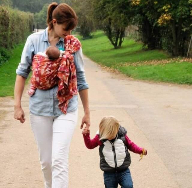 Mum with a sling and toddler